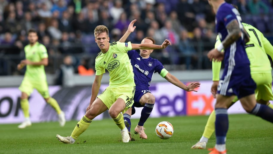 Dinamo Zagreb's Spanish midfielder Dani Olmo (L) vies with Anderlecht's French midfielder Adrien Trebel (R) during the Europa League Group D football match between Anderlecht and Dinamo Zagreb at the Constant Vanden Stock Stadium on October 4, 2018 in Brussels. (Photo by JOHN THYS / AFP)        (Photo credit should read JOHN THYS/AFP/Getty Images)