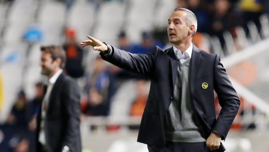 Young Boys' coach Adi Hutter gestures to his playesr during the UEFA Europa League football match between Cyprus' APOEL of Nicosia and Switzerland's BSC Young Boys of Bern on November 3, 2016, at the Neo GSP Stadium in Nicosia.  / AFP / Sakis Savvides        (Photo credit should read SAKIS SAVVIDES/AFP/Getty Images)