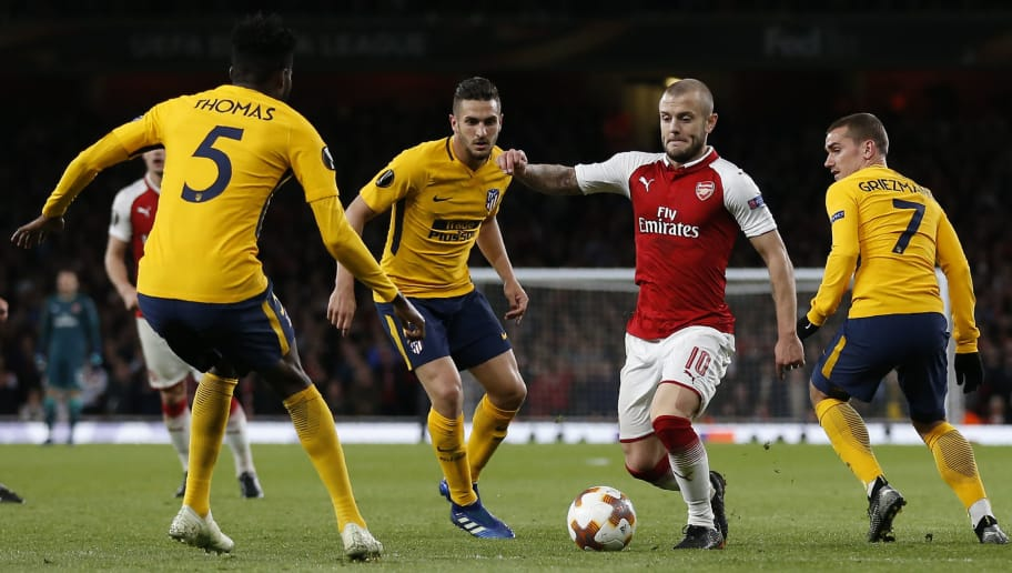 Arsenal's English midfielder Jack Wilshere (2nd R) is surrounded by Atletico players during the UEFA Europa League first leg semi-final football match  between Arsenal and Atletico Madrid at the Emirates Stadium in London on April 26, 2018. (Photo by Ian KINGTON / IKIMAGES / AFP)        (Photo credit should read IAN KINGTON/AFP/Getty Images)