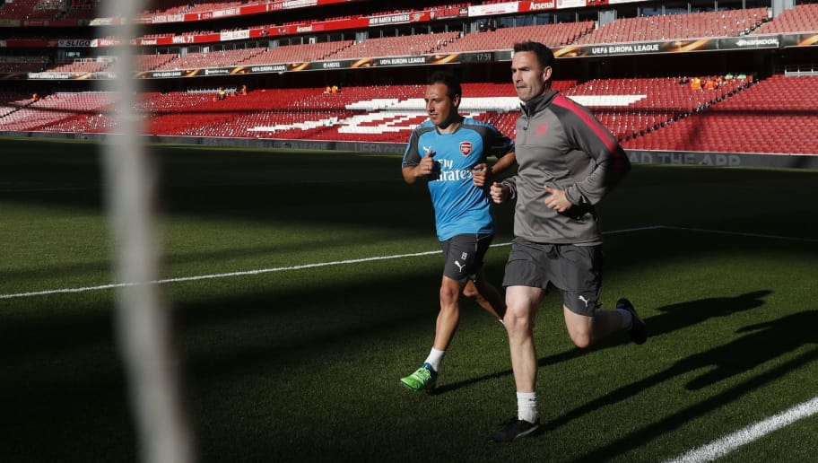 Arsenal's Spanish midfielder Santi Cazorla (L) trains on the pitch ahead of the UEFA Europa League first leg semi-final football match  between Arsenal and Atletico Madrid at the Emirates Stadium in London on April 26, 2018. (Photo by Adrian DENNIS / AFP)        (Photo credit should read ADRIAN DENNIS/AFP/Getty Images)