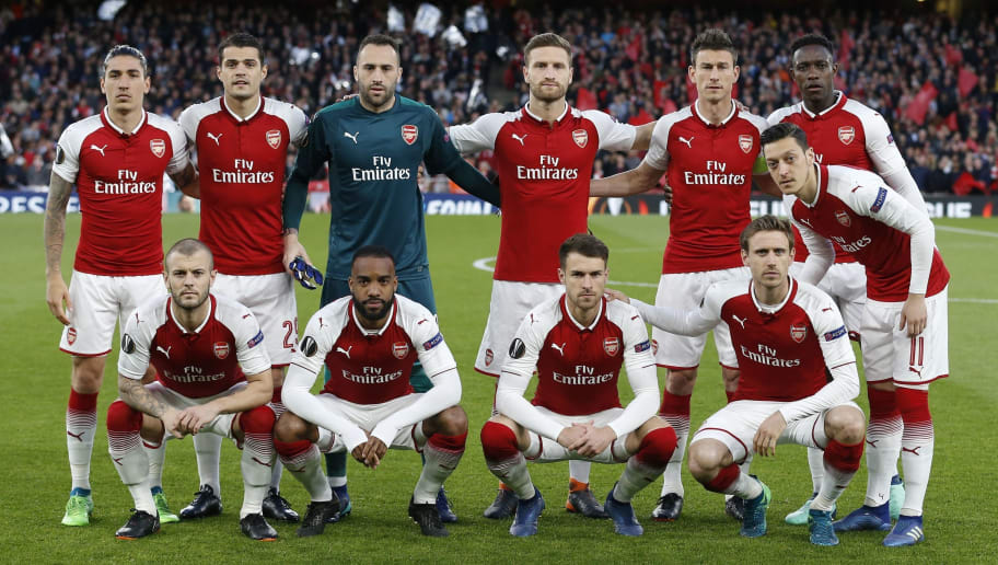 Arsenal players (back row L-R) Arsenal's Spanish defender Hector Bellerin, Arsenal's Swiss midfielder Granit Xhaka, Arsenal's Colombian goalkeeper David Ospina, Arsenal's German defender Shkodran Mustafi, Arsenal's French defender Laurent Koscielny and Arsenal's English striker Danny Welbeck, (front row L-R) Arsenal's English midfielder Jack Wilshere, Arsenal's French striker Alexandre Lacazette, Arsenal's Welsh midfielder Aaron Ramsey, Arsenal's Spanish defender Nacho Monreal and Arsenal's German midfielder Mesut Ozil  pose for a group photograph ahead of the UEFA Europa League first leg semi-final football match  between Arsenal and Atletico Madrid at the Emirates Stadium in London on April 26, 2018. (Photo by Ian KINGTON / IKIMAGES / AFP)        (Photo credit should read IAN KINGTON/AFP/Getty Images)