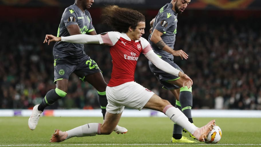 Arsenal's French midfielder Matteo Guendouzi (C) vies with Sporting's Portuguese midfielder Bruno Fernandes (R) during their UEFA Europa league football match at the Emirates stadium in London on November 8, 2018. (Photo by Adrian DENNIS / AFP)        (Photo credit should read ADRIAN DENNIS/AFP/Getty Images)