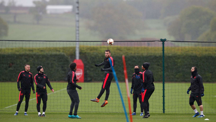 Arsenal's defender Calum Chambers (C) jumps to head the ball takes part in a training session at the club's complex in London Colney on May 2, 2018 on the eve of their UEFA Europa league second leg semi-final match against Atletico Madrid. (Photo by ADRIAN DENNIS / AFP)        (Photo credit should read ADRIAN DENNIS/AFP/Getty Images)