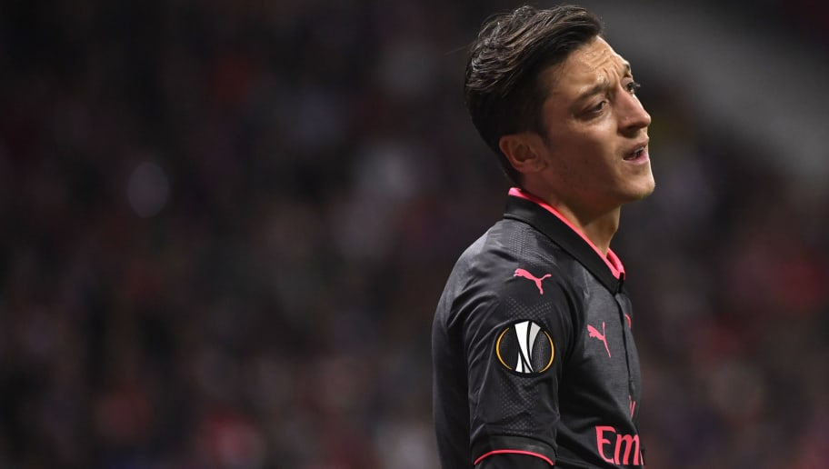 Arsenal's German midfielder Mesut Ozil gestures during the UEFA Europa League semi-final second leg football match between Club Atletico de Madrid and Arsenal FC at the Wanda Metropolitano stadium in Madrid on May 3, 2018.. (Photo by PIERRE-PHILIPPE MARCOU / AFP)        (Photo credit should read PIERRE-PHILIPPE MARCOU/AFP/Getty Images)