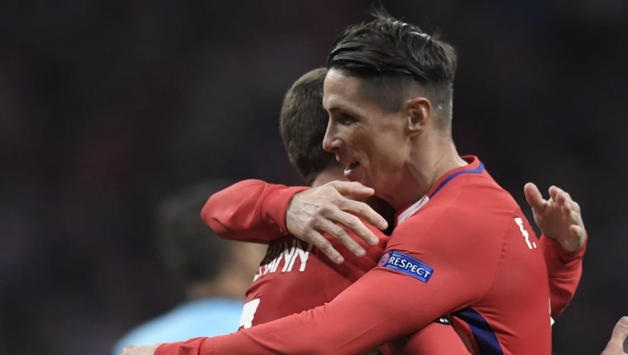 Atletico Madrid's Spanish forward Fernando Torres (R) and Atletico Madrid's French forward Antoine Griezmann celebrate at the end of the UEFA Europa League semi-final second leg football match between Club Atletico de Madrid and Arsenal FC at the Wanda Metropolitano stadium in Madrid on May 3, 2018.. (Photo by GABRIEL BOUYS / AFP)        (Photo credit should read GABRIEL BOUYS/AFP/Getty Images)