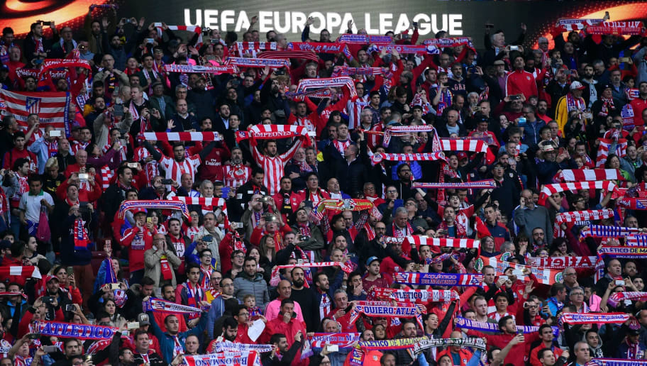 Atletico fans hold up scarves before the UEFA Europa League semi-final second leg football match between Club Atletico de Madrid and Arsenal FC at the Wanda Metropolitano stadium in Madrid on May 3, 2018. (Photo by PIERRE-PHILIPPE MARCOU / AFP)        (Photo credit should read PIERRE-PHILIPPE MARCOU/AFP/Getty Images)