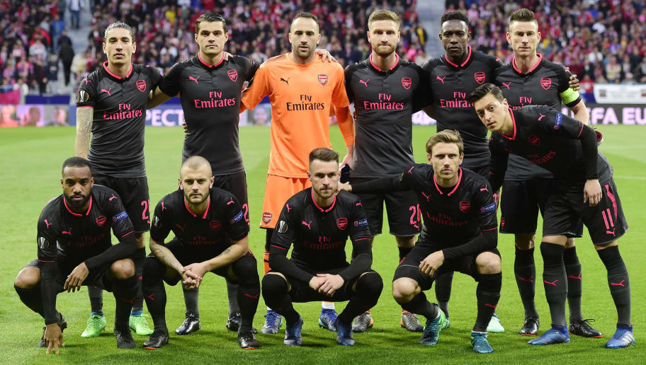 (BACK L-R) Arsenal's Spanish defender Hector Bellerin, Arsenal's Swiss midfielder Granit Xhaka, Arsenal's Colombian goalkeeper David Ospina, Arsenal's German defender Shkodran Mustafi, Arsenal's English forward Danny Welbeck, Arsenal's French defender Laurent Koscielny (FRONT L-R) Arsenal's French forward Alexandre Lacazette, Arsenal's English midfielder Jack Wilshere, Arsenal's Welsh midfielder Aaron Ramsey, Arsenal's Spanish defender Nacho Monreal and Arsenal's German midfielder Mesut Ozil pose before the UEFA Europa League semi-final second leg football match between Club Atletico de Madrid and Arsenal FC at the Wanda Metropolitano stadium in Madrid on May 3, 2018. (Photo by PIERRE-PHILIPPE MARCOU / AFP)        (Photo credit should read PIERRE-PHILIPPE MARCOU/AFP/Getty Images)