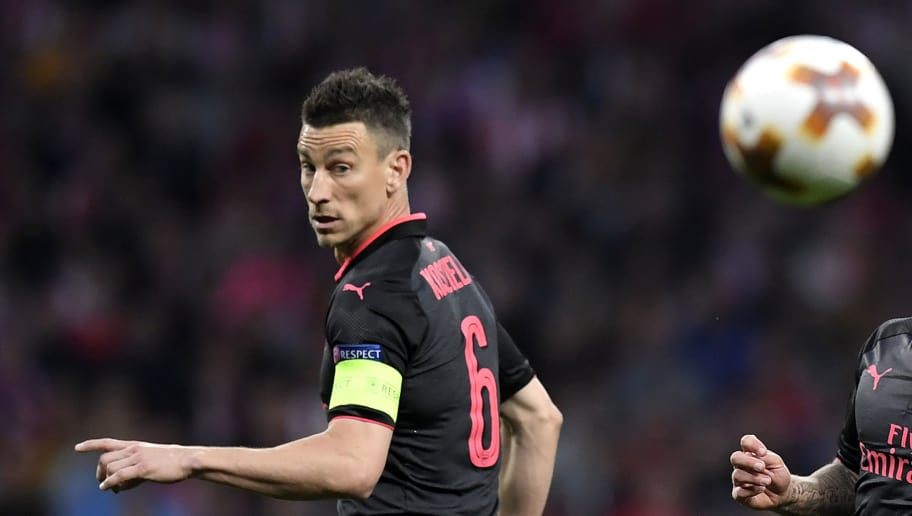Arsenal's French defender Laurent Koscielny eyes the ball during the UEFA Europa League semi-final second leg football match between Club Atletico de Madrid and Arsenal FC at the Wanda Metropolitano stadium in Madrid on May 3, 2018. (Photo by GABRIEL BOUYS / AFP)        (Photo credit should read GABRIEL BOUYS/AFP/Getty Images)