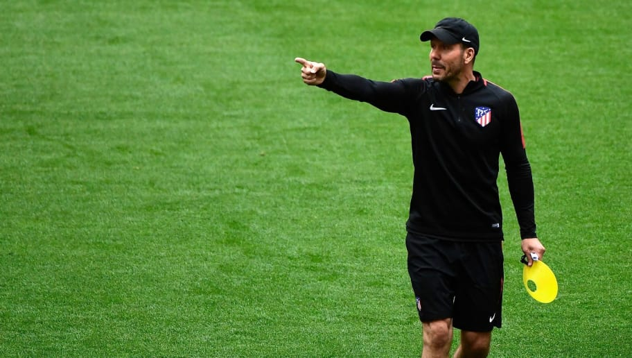 Atletico Madrid's Argentinian coach Diego Simeone gestures during a training session for Atletico Madrid's Media Open Day at the Wanda Metropolitan Stadium in Madrid on May 9, 2018 ahead of the UEFA Europa League final against Marseille in Lyon. (Photo by PIERRE-PHILIPPE MARCOU / AFP)        (Photo credit should read PIERRE-PHILIPPE MARCOU/AFP/Getty Images)