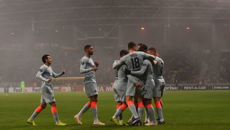 Chelsea's French striker Olivier Giroud (#18) celebrates with teammates after scoring a goal during the UEFA Europa League group L football match between FC BATE Borisov and Chelsea FC in Borisov outside Minsk on November 8, 2018. (Photo by Kirill KUDRYAVTSEV / AFP)        (Photo credit should read KIRILL KUDRYAVTSEV/AFP/Getty Images)