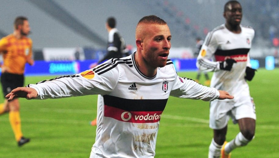 Besiktas' Gokhan Tore (L) celebrates after Besiktas'  Demba Ba (R) scored his team's second goal  during the UEFA Europa League Group C match Besiktas JK vs FK Partizan on November 6, 2014 at Ataturk Olympic stadium in Istanbul. AFP PHOTO/OZAN KOSE        (Photo credit should read OZAN KOSE/AFP/Getty Images)