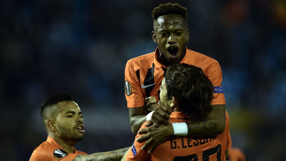 Shakhtar Donetsk's Argentinian forward Gustavo Blanco Leschuk (bottom R) celebrates with teammate Brazilian midfielder Fred (top) after scoring a goal during the Europa League round of 32 first leg football match RC Celta de Vigo vs FC Shakhtar Donetsk at the Balaidos stadium in Vigo on February 16, 2017. / AFP PHOTO / MIGUEL RIOPA AND -        (Photo credit should read MIGUEL RIOPA/AFP/Getty Images)