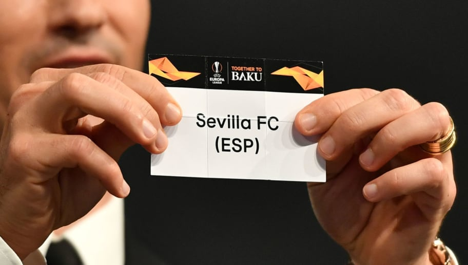 Former Portuguese football player Ricardo Carvalho shows the slip of Sevilla FC during the draw for the round of 32 of the UEFA Europa League football tournament at the UEFA headquarters in Nyon on December 17, 2018. (Photo by Fabrice COFFRINI / AFP)        (Photo credit should read FABRICE COFFRINI/AFP/Getty Images)