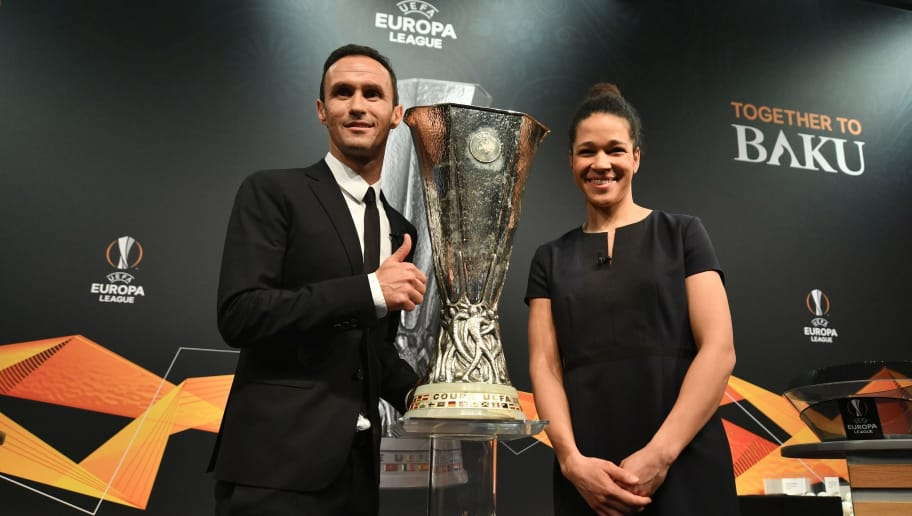 Former German football Celia Sasic (R) and Former Portuguese football player Ricardo Carvalho pose with the cup after the draw for the round of 32 of the UEFA Europa League football tournament at the UEFA headquarters in Nyon on December 17, 2018. (Photo by Fabrice COFFRINI / AFP)        (Photo credit should read FABRICE COFFRINI/AFP/Getty Images)
