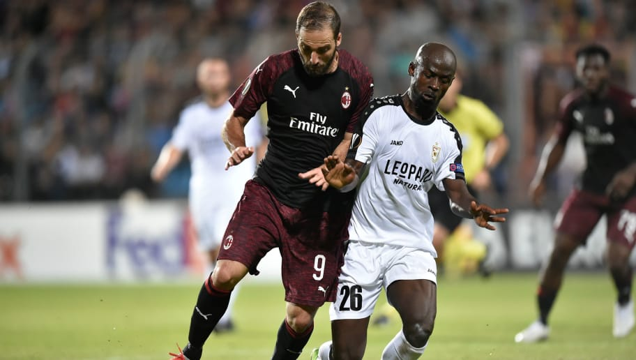AC Milan's Argentinian forward Gonzalo Higuain (L) vies with Dudelange's defender Jerry Prempeh (R) during the UEFA Europa League Group F football match between F91 Dudelange and AC Milan at the Josy Barthel Stadium in Luxembourg, on September 20, 2018. (Photo by JOHN THYS / AFP)        (Photo credit should read JOHN THYS/AFP/Getty Images)