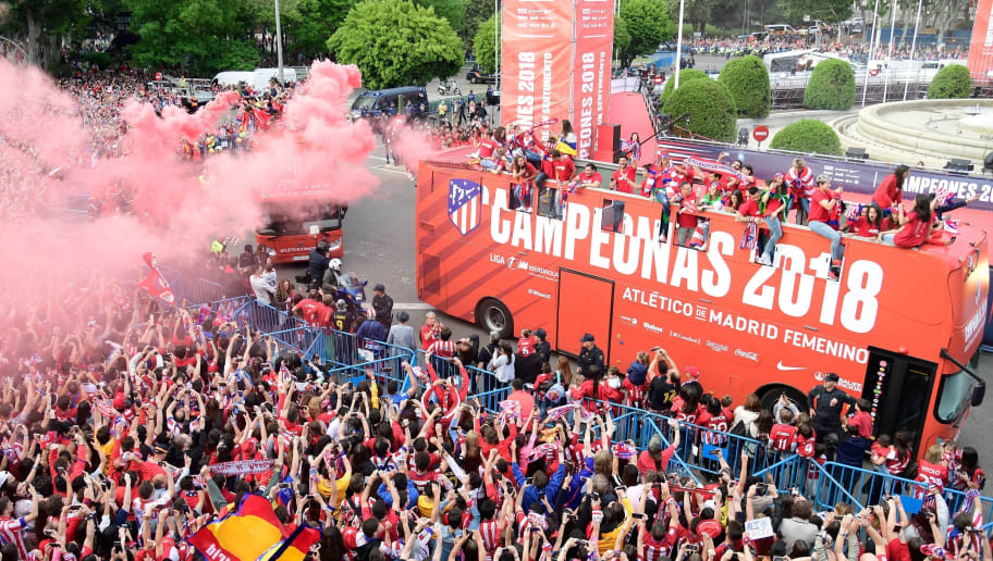 Atletico Madrid's players parade aboard an open-top bus to celebrate their Europa League victory at the Fountain of Neptune in Madrid on May 18, 2018. (Photo by JAVIER SORIANO / AFP)        (Photo credit should read JAVIER SORIANO/AFP/Getty Images)