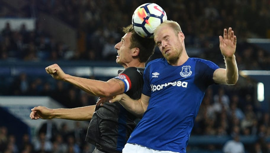 Everton's Dutch midfielder Davy Klaassen (R) vies with Hajduk Split's Croatian defender Zoran Nizic during the UEFA Europa League playoff round, first leg football match between Everton and Hajduk Split at Goodison Park in Liverpool, north west England on August 17, 2017. / AFP PHOTO / Oli SCARFF        (Photo credit should read OLI SCARFF/AFP/Getty Images)