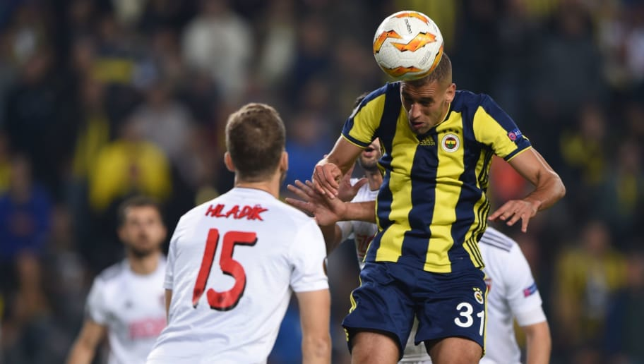 Fenerbahce's Algerian forward Islam Slimani (R) heads the ball next to Spartak Trnava's defender Ivan Hladík (L) during the Europa League Group D match between Fenerbahce and Spartak Trnave at the Fenerbahce Ulker Stadium in Istanbul on October 4, 2018. (Photo by BULENT KILIC / AFP)        (Photo credit should read BULENT KILIC/AFP/Getty Images)