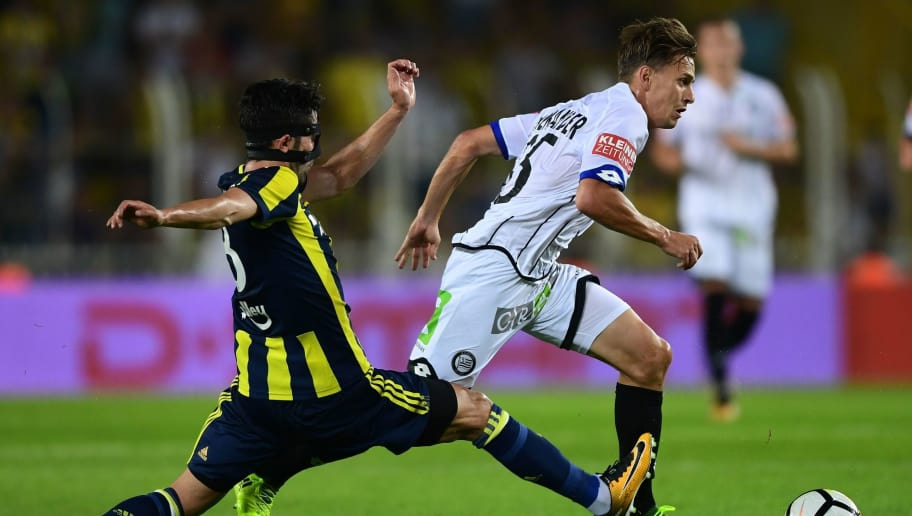 Sturm Graz`s Thorsten Röcher (R) fights for the ball with Fenerbahce`s Hasan Ali Kaldirim (L) during the UEFA Europa League third qualifying round second match between Fenerbahce and Sturm Graz at Fenerbahce's Ulker Stadium in Istanbul on August 3, 2017. / AFP PHOTO / OZAN KOSE        (Photo credit should read OZAN KOSE/AFP/Getty Images)
