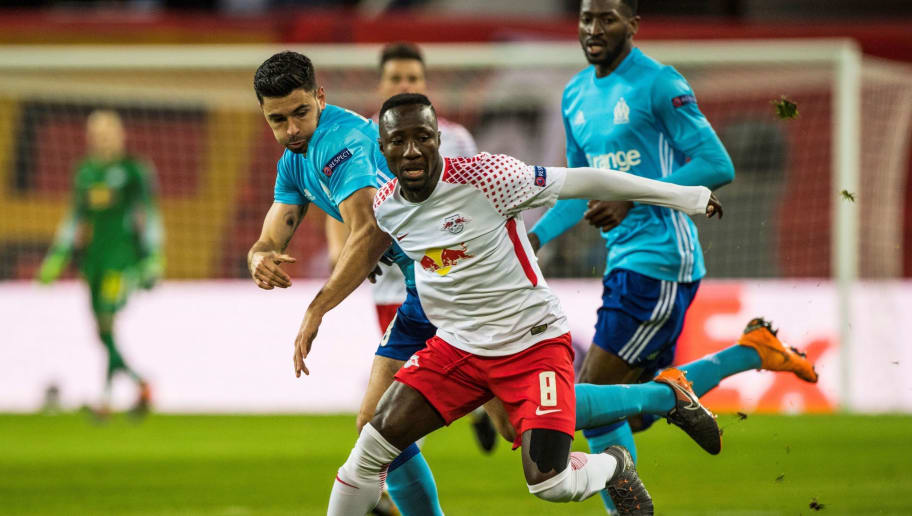 Leipzig's Guinean midfielder Naby Keita (R) vies with Marseille's French midfielder Morgan Sanson during the UEFA Europa League quarter-final first leg football match RB Leipzig vs Olympique de Marseille (OM) at the RB arena in Leipzig, eastern Germany, on April 5, 2018. / AFP PHOTO / John MACDOUGALL        (Photo credit should read JOHN MACDOUGALL/AFP/Getty Images)