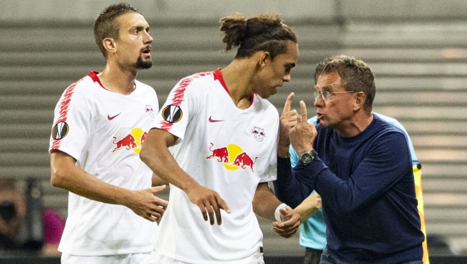 Leipzig's head coach Ralf Rangnick (R) gestures next to Danish forward Yussuf Poulsen (C) and Austrian midfielder Stefan Ilsanker during the UEFA Europa League 1st round Group B football match between RB Leipzig and Salzburg on September 20, 2018 in Leipzig. (Photo by ROBERT MICHAEL / AFP)        (Photo credit should read ROBERT MICHAEL/AFP/Getty Images)