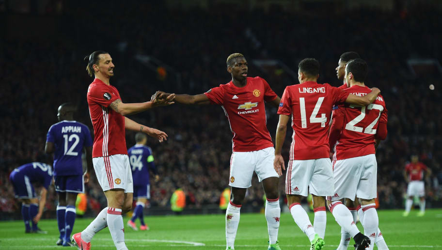 Manchester United's French midfielder Paul Pogba (2L) shakes hands with Manchester United's Swedish striker Zlatan Ibrahimovic (L) as they celebrate the opening goal scored by Manchester United's Armenian midfielder Henrikh Mkhitaryan (R) during the UEFA Europa League quarter-final second leg football match between Manchester United and Anderlecht at Old Trafford in Manchester, north west England, on April 20, 2017. / AFP PHOTO / Oli SCARFF        (Photo credit should read OLI SCARFF/AFP/Getty Images)