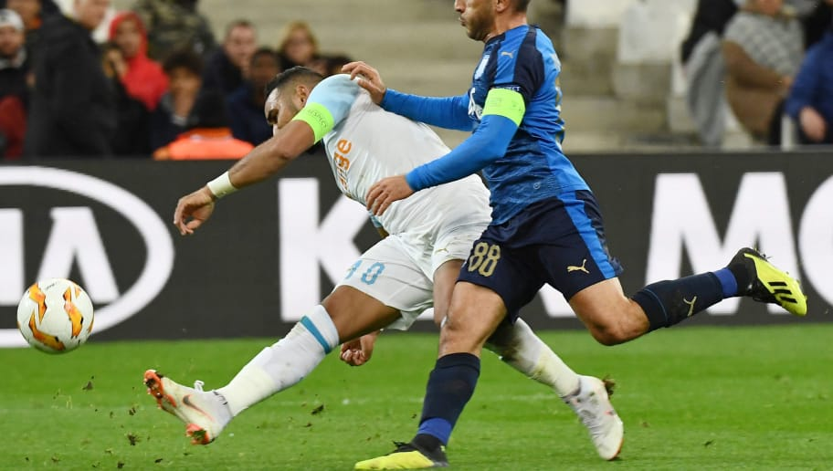 Olympique de Marseille's French forward Dimitri Payet (L) competes for the ball during the UEFA Europa League Group H football match between Olympique de Marseille and Apollon Limassol FC at the Velodrome stadium in Marseille, southern France on December 13, 2018. (Photo by Boris HORVAT / AFP)        (Photo credit should read BORIS HORVAT/AFP/Getty Images)