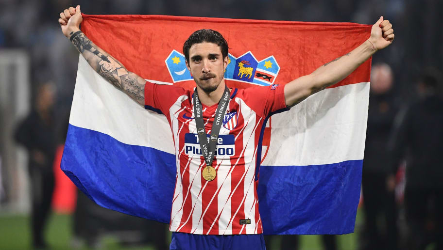 Atletico Madrid's Croatian defender Sime Vrsaljko celebrates after the UEFA Europa League final football match between Olympique de Marseille and Club Atletico de Madrid at the Parc OL stadium in Decines-Charpieu, near Lyon on May 16, 2018. (Photo by FRANCK FIFE / AFP)        (Photo credit should read FRANCK FIFE/AFP/Getty Images)