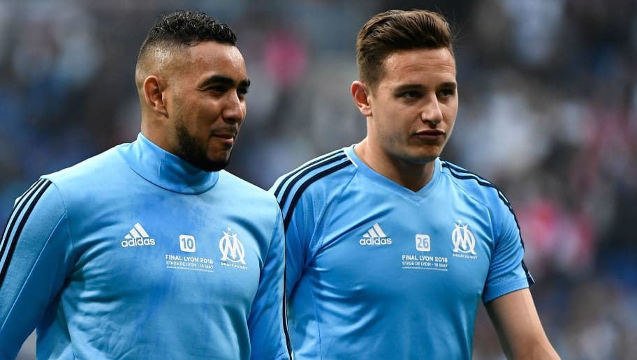 Marseille's French forward Dimitri Payet (L) and Marseille's French midfielder Florian Thauvin warm up prior to the UEFA Europa League final football match between Olympique de Marseille and Club Atletico de Madrid at the Parc OL stadium in Decines-Charpieu, near Lyon on May 16, 2018. (Photo by JEFF PACHOUD / AFP)        (Photo credit should read JEFF PACHOUD/AFP/Getty Images)