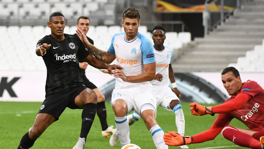 Frankfurt's French forward Sebastien Haller (L) vies for the ball with with Marseille's Croatian defender Duje Caleta Car (C) and Marseille's French goalkeeper Yohan Pele (R)  during the UEFA Europa League Group H first-leg football match between Marseille (OM) and Eintracht Frankfurt at the Velodrome stadium in Marseille, southeastern France, on September 20, 2018. (Photo by Boris HORVAT / AFP)        (Photo credit should read BORIS HORVAT/AFP/Getty Images)