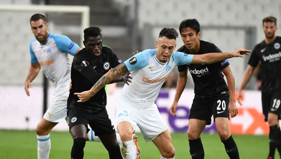 Marseille's Argentine midfielder Lucas Ocampos (C) vies for the ball with   Frankfurt's German defender Danny da Costa (L) and Frankfurt's Japanese midfielder Makoto Hasebe during the UEFA Europa League Group H first-leg football match between Marseille (OM) and Eintracht Frankfurt at the Velodrome stadium in Marseille, southeastern France, on September 20, 2018. (Photo by Boris HORVAT / AFP)        (Photo credit should read BORIS HORVAT/AFP/Getty Images)
