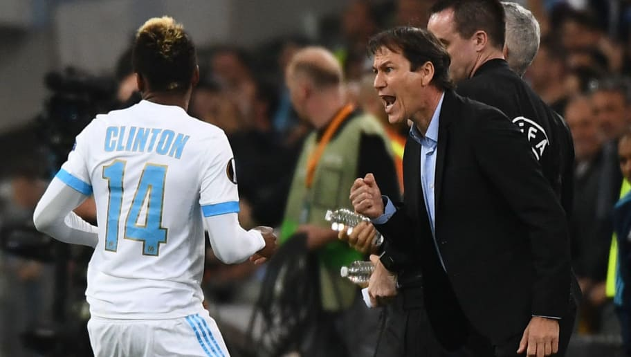 Marseille's Cameroonian forward Clinton Njie (L) celebrates with Marseille's French head coach Rudi Garcia after he scored a goal during the UEFA Europa League first-leg semi-final football match between Olympique de Marseille and FC Salzburg at the Velodrome Stadium in Marseille, southeastern France, on April 26, 2018. (Photo by Boris HORVAT / AFP)        (Photo credit should read BORIS HORVAT/AFP/Getty Images)