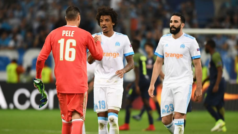 Marseille's French goalkeeper Yohann Pele, Brazilian midfielder Luiz Gustavo and French defender Adil Rami celebrate their victory at the end of the UEFA Europa League first-leg semi-final football match between Olympique de Marseille and FC Salzburg at the Velodrome Stadium in Marseille, southeastern France, on April 26, 2018. (Photo by Boris HORVAT / AFP)        (Photo credit should read BORIS HORVAT/AFP/Getty Images)