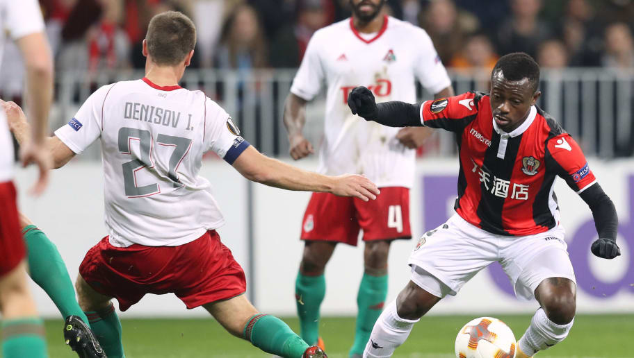 Nice's Ivorian midfielder Jean Michael Seri (R) vies with Lokomotiv Igor Denisov (L) during the UEFA Europa League football match between Nice and Lokomotiv Moscow on February 15, 2018, at the Allianz Riviera stadium in Nice, southeastern France.   / AFP PHOTO / VALERY HACHE        (Photo credit should read VALERY HACHE/AFP/Getty Images)