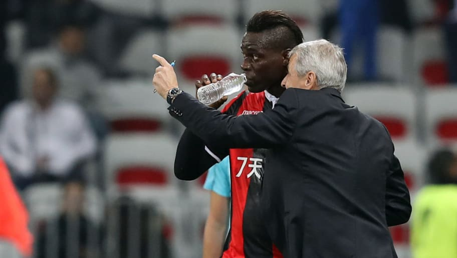 Nice's Italian forward Mario Balotelli (L) listens to Nice's Swiss head coach Lucien Favre after scoring a goal during the UEFA Europa League football match between OGC Nice vs Zulte Waregem on November 23, 2017 at the 'Allianz Riviera Stadium' in Nice, southeastern France.   / AFP PHOTO / VALERY HACHE        (Photo credit should read VALERY HACHE/AFP/Getty Images)