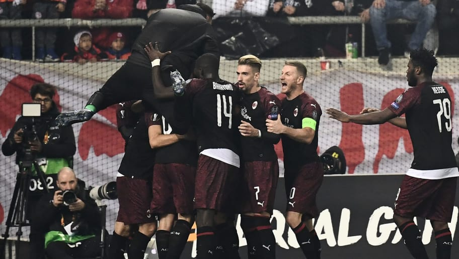 AC Milan's players celebrate after scoring during their UEFA Europa league match Olympiacos FC and AC Milan at the Karaiskaki stadium in Piraeus on December 13, 2018. (Photo by ARIS MESSINIS / AFP)        (Photo credit should read ARIS MESSINIS/AFP/Getty Images)