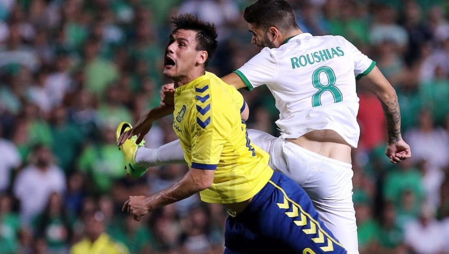 Danish Brondby's Dario Dumic fights for the ball against Cypriot AC Omonoia's Onisiforos Roushias (R) during their UEFA Europa League football match at G.S.P Stadium in Nicosia, on August 6, 2015. AFP PHOTO / SAKIS SAVIDES        (Photo credit should read SAKIS SAVIDES/AFP/Getty Images)