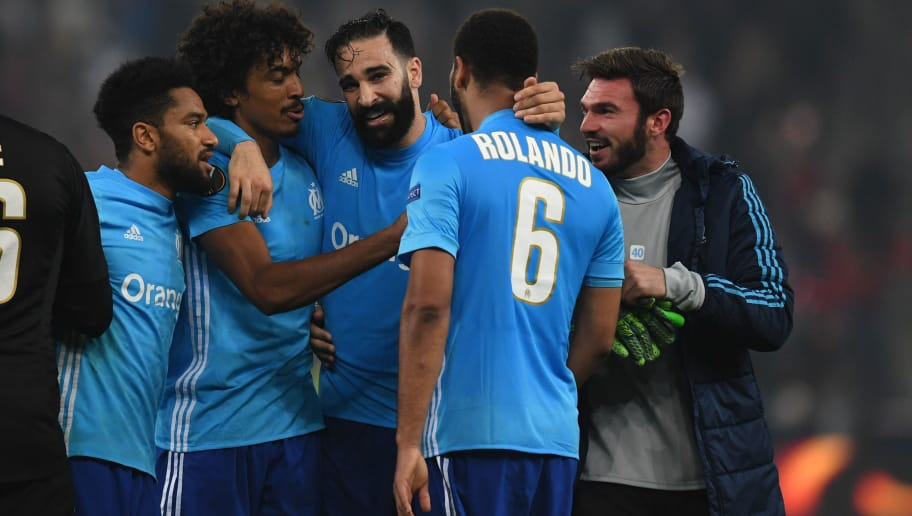 Marseille's defender from France Adil Rami (C) and teammates celebrate after the UEFA Europa League semi-final second leg match between FC Salzburg and Olympique de Marseille (OM) on May 3, 2018 in Salzburg, Austria. - Marseille booked a Europa League final against Atletico Madrid after Portugal defender Rolando struck in extra time to grab a 3-2 aggregate victory over a spirited Salzburg. (Photo by Christof STACHE / AFP)        (Photo credit should read CHRISTOF STACHE/AFP/Getty Images)