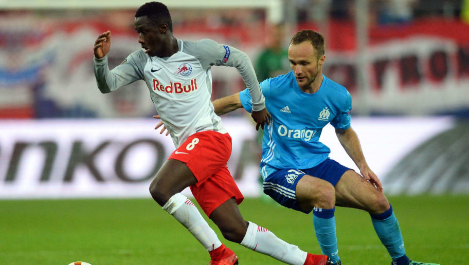 Marseille's French forward Valere Germain vies with Salzburg's Malian midfielder Diadie Samassekou during the UEFA Europa League semi-final second leg match between FC Salzburg and Olympique de Marseille (OM) on May 3, 2018 in Salzburg, Austria. (Photo by VLADIMIR SIMICEK / AFP)        (Photo credit should read VLADIMIR SIMICEK/AFP/Getty Images)