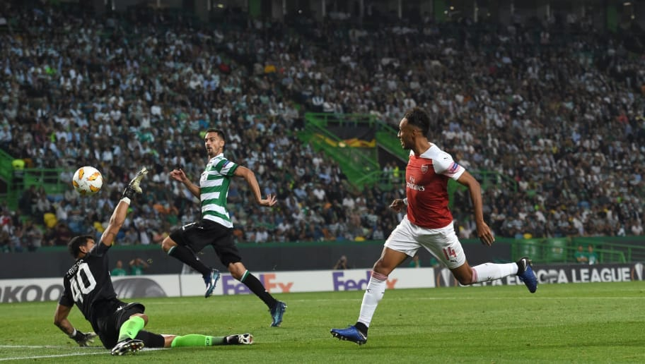 Arsenal's French forward Pierre-Emerick Aubameyang (R) kicks the ball but fails to score a goal during the UEFA Europa League group E football match Sporting CP vs Arsenal FC at the Alvalade stadium in Lisbon on October 25, 2018. (Photo by Francisco LEONG / AFP)        (Photo credit should read FRANCISCO LEONG/AFP/Getty Images)