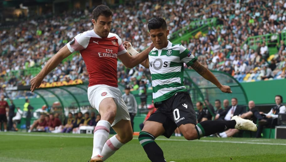 Arsenal's Greek defender Sokratis Papastathopoulos (L) vies with Sporting's Colombian forward Fredy Montero during the UEFA Europa League group E football match Sporting CP vs Arsenal FC at the Alvalade stadium in Lisbon on October 25, 2018. (Photo by Francisco LEONG / AFP)        (Photo credit should read FRANCISCO LEONG/AFP/Getty Images)