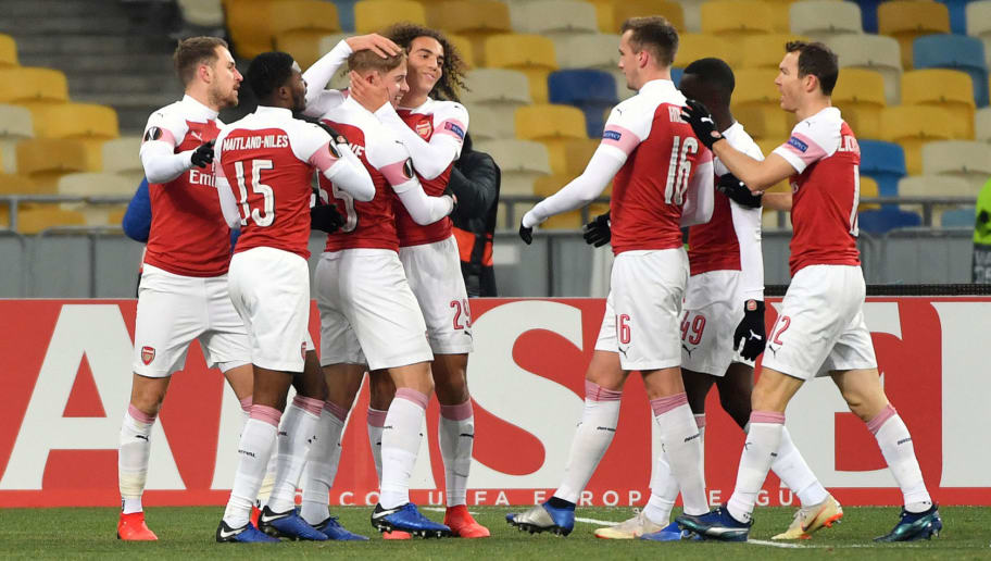 Arsenal players celebrate a goal during UEFA Europa League, Group E, football match Vorskla FC vs Arsenal FC at the Olympiyski Stadium in Kiev on November 29, 2018. (Photo by SERGEI SUPINSKY / AFP)        (Photo credit should read SERGEI SUPINSKY/AFP/Getty Images)
