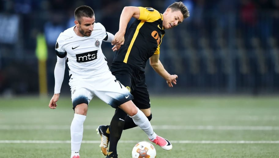 Young Boys' Christian Fassnacht (R) fights for the ball with Partizan's Zoran Tosic during the UEFA Europa League Group B football match between BSC Young Boys and FK Partizan Belgrade at The Stade de Suisse in Bern on September 14, 2017. / AFP PHOTO / Michael Buholzer        (Photo credit should read MICHAEL BUHOLZER/AFP/Getty Images)