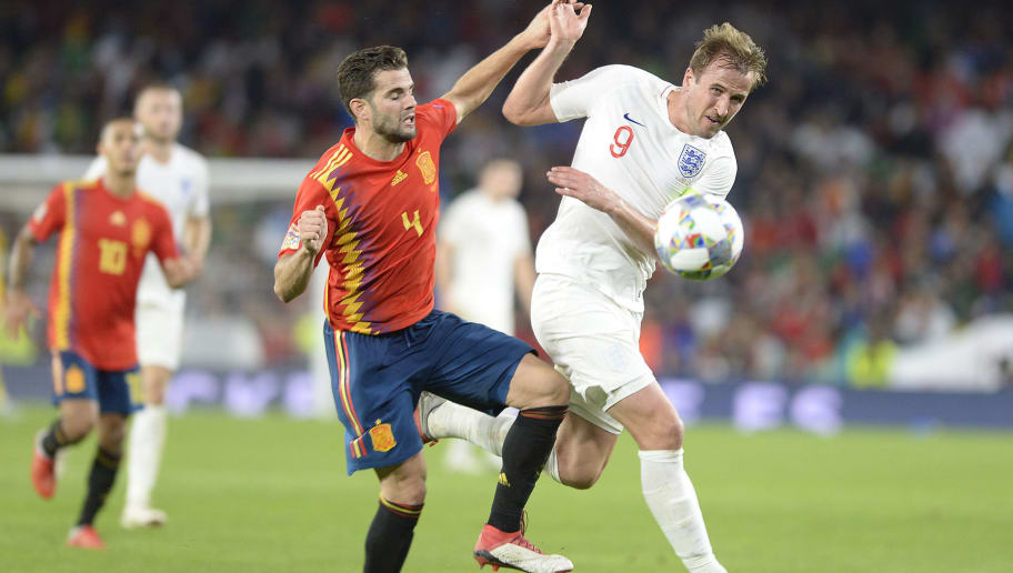 England's forward Harry Kane (R) vies for the ball with Spain's defender Nacho (L) during the UEFA Nations League football match between Spain and England on October 15, 2018 at the Benito Villamarin stadium in Sevilla. (Photo by CRISTINA QUICLER / AFP)        (Photo credit should read CRISTINA QUICLER/AFP/Getty Images)