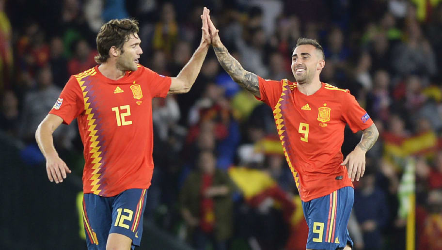 Spain's striker Paco Alcacer (R) celebrates with Spain's defender Marcos Alonso after scoring a goal during the UEFA Nations League football match between Spain and England on October 15, 2018 at the Benito Villamarin stadium in Sevilla. (Photo by CRISTINA QUICLER / AFP)        (Photo credit should read CRISTINA QUICLER/AFP/Getty Images)