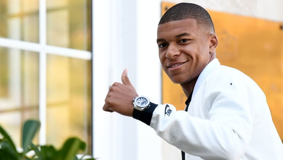 French forward Kylian Mbappe arrives at France's national football team training base in Clairefontaine en Yvelines on October 8, 2018, for the team's preparation ahead of the upcoming friendly match against Iceland and the Nations League match against Germany. (Photo by FRANCK FIFE / AFP)        (Photo credit should read FRANCK FIFE/AFP/Getty Images)