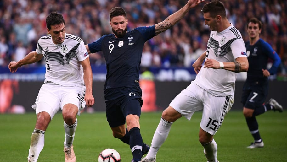 France's forward Olivier Giroud (C) vies with Germany's defender Mats Hummels (L) and Germany's defender Niklas Suele during the UEFA Nations League football match between France and Germany at the Stade de France in Saint-Denis, near Paris on October 16, 2018. (Photo by FRANCK FIFE / AFP)        (Photo credit should read FRANCK FIFE/AFP/Getty Images)