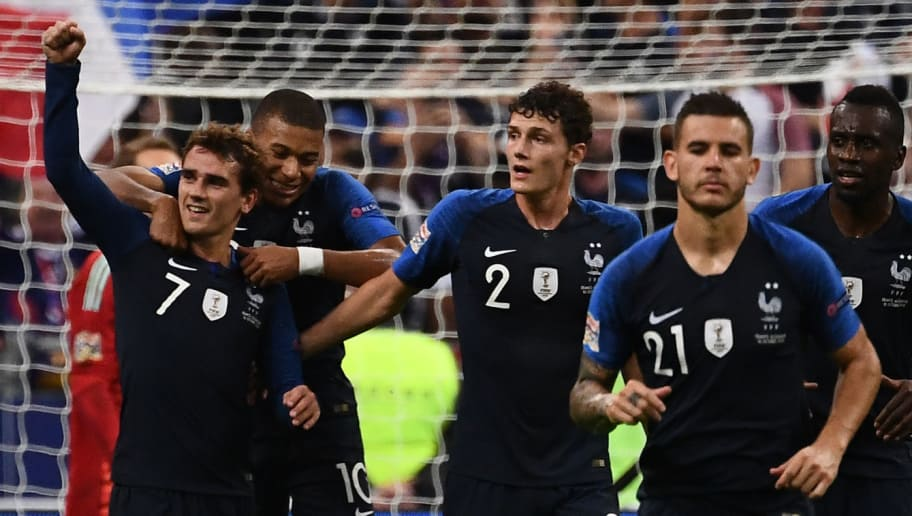 France's forward Antoine Griezmann (L) celebrates with teammates after scoring their second goal during the UEFA Nations League football match between France and Germany at the Stade de France in Saint-Denis, near Paris on October 16, 2018. (Photo by Anne-Christine POUJOULAT / AFP)        (Photo credit should read ANNE-CHRISTINE POUJOULAT/AFP/Getty Images)