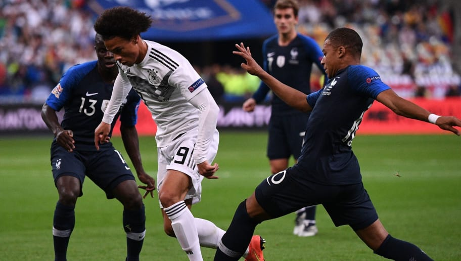 Germany's midfielder Leroy Sane (C) vies with France's midfielder Kylian Mbappe (R) during the UEFA Nations League football match between France and Germany at the Stade de France in Saint-Denis, near Paris on October 16, 2018. (Photo by FRANCK FIFE / AFP)        (Photo credit should read FRANCK FIFE/AFP/Getty Images)