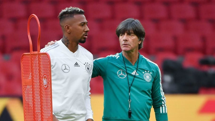 German defender Jerome Boateng (L) and German coach Joachim Low take part in a training session a day before the UEFA Nations League football match between the Netherlands and Germany at the Johan Cruijff Arena in Amsterdam on October 12, 2018. (Photo by Emmanuel DUNAND / AFP)        (Photo credit should read EMMANUEL DUNAND/AFP/Getty Images)